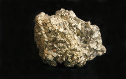 Mineral iron pyrite fool's gold nugget. Nugget of mineral iron pyrite also known as fool's gold because of its resemblance to gold. Concept for business, wealth royalty free stock images
