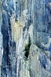 Mineral Kyanithe Distehn. Closeup of a piece of mineral, Kyanithe Distehn, blue needles with some other crystallized material royalty free stock photo