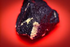 Mineral on red background, jasper Royalty Free Stock Images