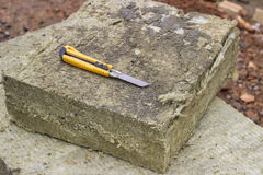 Mineral rockwool panel with a craft knive. At construction site. Selective focus Stock Photo