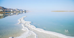 Mineral salt on the shore of the Dead Sea Stock Photos