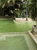 Mineral Springs. A mineral springs with green water produced by copper and other minerals in the water that are said to promote health and well being Stock Images
