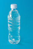 Mineral still water. Bottle of mineral still water on blue royalty free stock photos