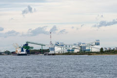 Mineral transshipment at port. Royalty Free Stock Photo