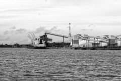Mineral transshipment at port. Royalty Free Stock Images