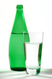 Mineral Water 06. Glass of Mineral Water and Green Bottle stock images