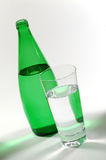 Mineral Water 07. Glass of Mineral Water and Green Bottle stock photos