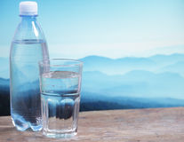 Mineral water. Against mountain landscape stock photography