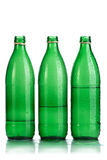 Mineral water. Green bottle of mineral water on a white background Royalty Free Stock Photography