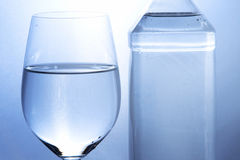 Mineral Water. Close-up of glass and bottle with mineral water royalty free stock photo
