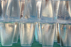 Mineral water. Stack of mineral water on plastic cup containers Stock Photos