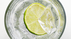 Mineral water. And limette and ice cube Stock Photo