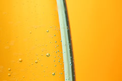 Mineral water air bubbles orange background Stock Images