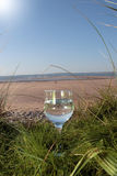 Mineral water on the beach Stock Photography