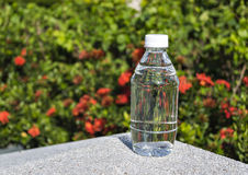 Mineral water. With bokeh background Royalty Free Stock Photos