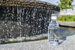 Mineral water. With bokeh background Royalty Free Stock Photo