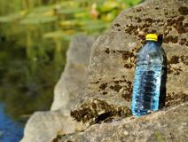 Mineral water in a bottle on a hot day Stock Image