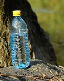 Mineral water in a bottle on a hot day Stock Images