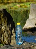 Mineral water in a bottle on a hot day Stock Photos