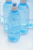 Mineral water. Bottles close-up Stock Photos