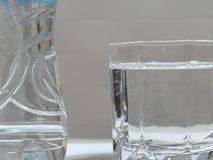 Mineral water. Close up of a bottle and glass full of water Stock Image