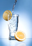 Mineral water glass with lemon Royalty Free Stock Photos