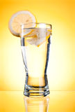 Mineral water in glass with a lemon Stock Photo
