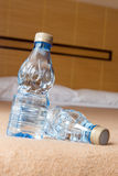 Mineral water in hotel room Royalty Free Stock Images