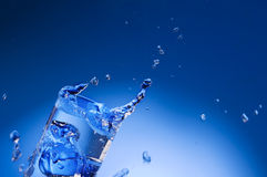 Mineral water splashing out from glass Royalty Free Stock Image
