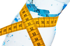 Mineral water. Symbol for weight loss Royalty Free Stock Photography