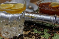 Coffee on wooden table and old manual coffee grinder stock photo