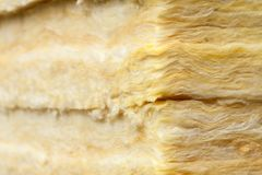 Mineral wool thermal insulation batts close-up. Mineral wool or mineral fiber, mineral cotton, mineral fibre, glass wool, MMMF, MMVF fiber thermal insulation Royalty Free Stock Image