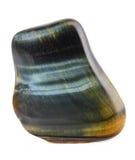 Minerale dell'occhio del falco - macro isolata su fondo bianco Immagini Stock
