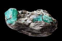Minerale metallifero con gli smeraldi Fotografia Stock