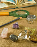 Minerals, atlas, magnifier, pencil and compass Stock Photo