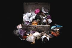 Minerals and gems in the steel box Royalty Free Stock Image