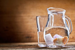 Minerals submerged in jug of water Royalty Free Stock Images