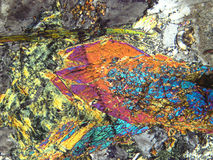 Minerals under microscope. Coloured minerals in pertographic microscope Stock Image