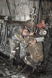 Minero en una mina Imágenes de archivo libres de regalías