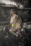 Minero en una mina Foto de archivo libre de regalías