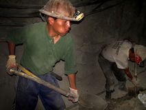 Miners of Cerro Rico, Bolivia, South America. Almost all miners in Potosi, Bolivia, have a cheek's deformation due to the continuous chewing of coca leaves used stock image