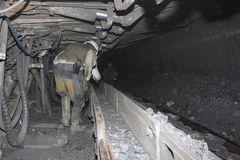 Miners are in the close tunnel of the underground mine Stock Images