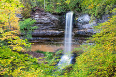 Miners Falls in Autumn - Munising Michigan - Pictured Rocks. Miners Falls framed by autumn foliage. Just minutes away from downtown Munising Michigan, Miners Stock Photos