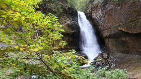 Miners Falls - Pictured Rocks - Munising Michigan. Miners Falls spills through a canyon before running along Miners River and spilling into Lake Superior in the stock video