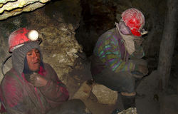 Miners in Potosi, Bolivia. Miners in the mine of Potosi, Bolivia, South America. Once famous for its silver, is now used to extract more common minerals. The royalty free stock photo