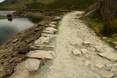 Miners Track crossing bridge at Llyn Llydaw on Snowdon. Royalty Free Stock Images
