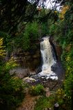 Miners waterfall in pictured rocks, Munising. MI, USA. Colorful autumn forest around waterfall Stock Photos
