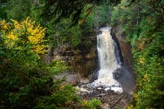 Miners waterfall in pictured rocks, Munising. MI, USA. Colorful autumn forest around waterfall Royalty Free Stock Photo