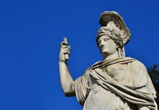 Minerva as Dea Roma. Minerva as Goddess Roma neoclassical old marble statue in People`s Square in Rome with copy space Royalty Free Stock Images