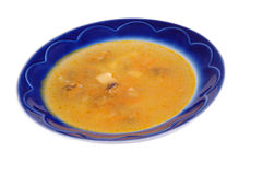 Minestra in un piatto immagine stock